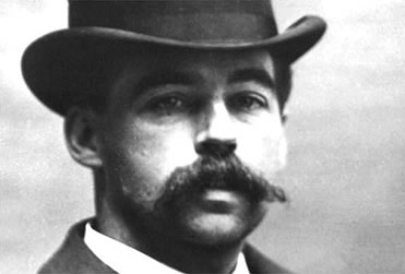 H.H. Holmes built a hotel of death (AKA Murder Caste) during Chicago's World Fair. I would be even more afraid to visit the site of the hotel today because I am afraid of waiting in line, and it is a U.S. Post Office.